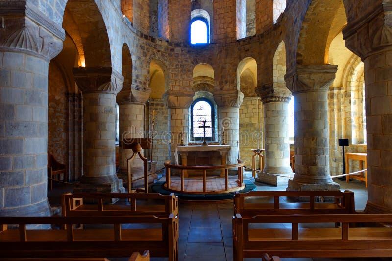Romanesque Saint John's Chapel Tower of London. Interior view of the stone Romanesque Saint John's Chapel located within the Tower of London stock photo