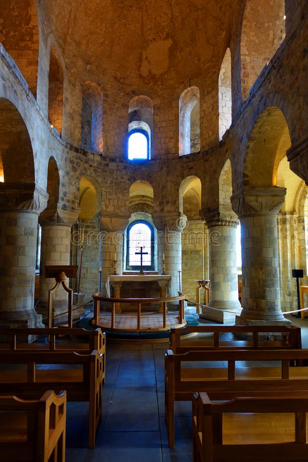 Saint John's Chapel Tower of London. Interior view of the stone Romanesque Saint John's Chapel located within the Tower of London complex stock photo