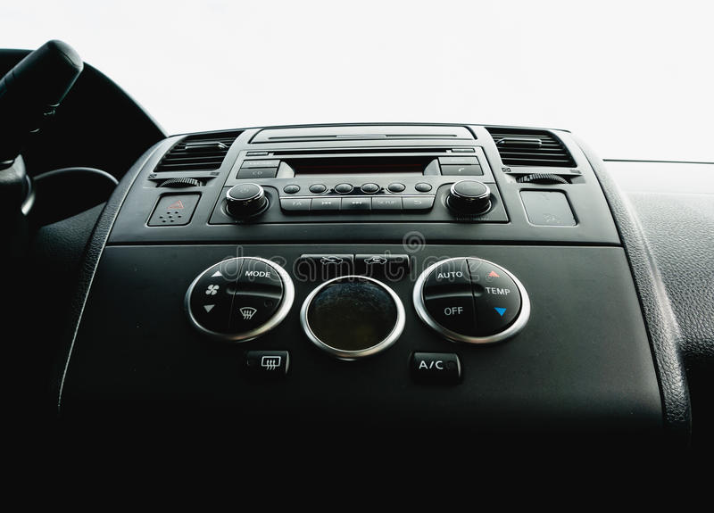 Interior view of vehicle. Modern technology car dashboard close up. Climate. Control and car audio panel royalty free stock photography