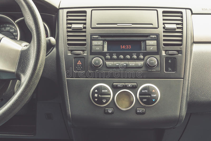 Interior view of vehicle. Modern technology car dashboard close up. Climate. Control and car audio panel stock photos