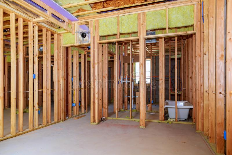 Interior wall framing with piping installation in the basement Bathroom remodel under floor plumbing work royalty free stock image