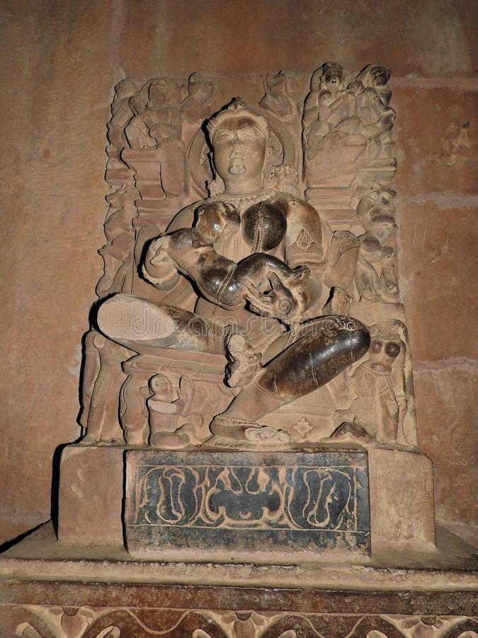 Interior, on the walls of ancient Kama Sutra temples in India kajuraho. UNESCO world heritage site. India`s most famous landmark. Temple of love stock photography