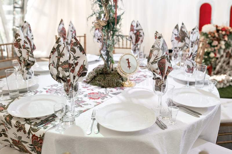 Interior of a wedding tent decoration ready for guests. Served round banquet table outdoor in marquee decorated flowers stock photos