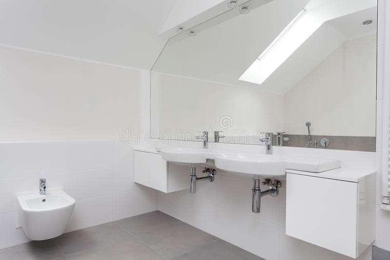 Interior of a white bathroom. Interior of a white elegant bathroom with double sink stock images