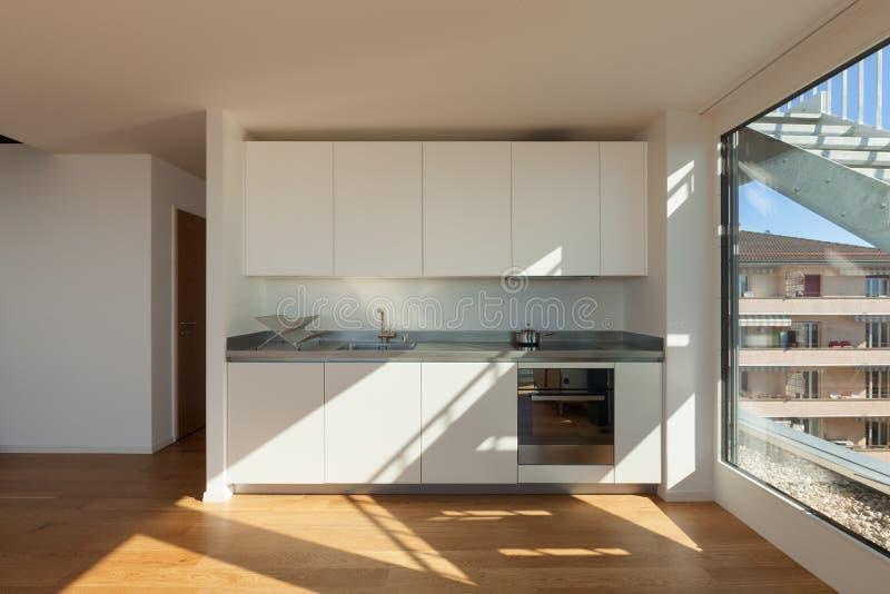 Interior, white domestic kitchen. Interior of nice apartment, white domestic kitchen royalty free stock photos
