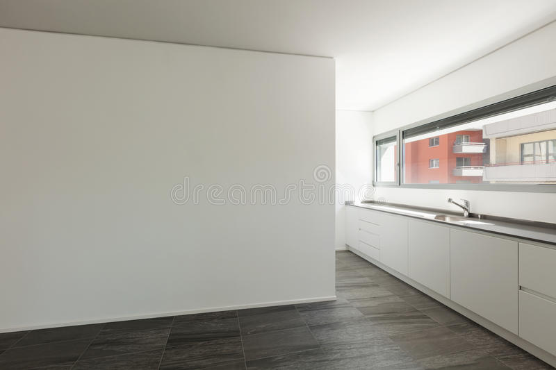 Interior, wide room with domestic kitchen. Interior of empty apartment, wide room with domestic kitchen stock photography