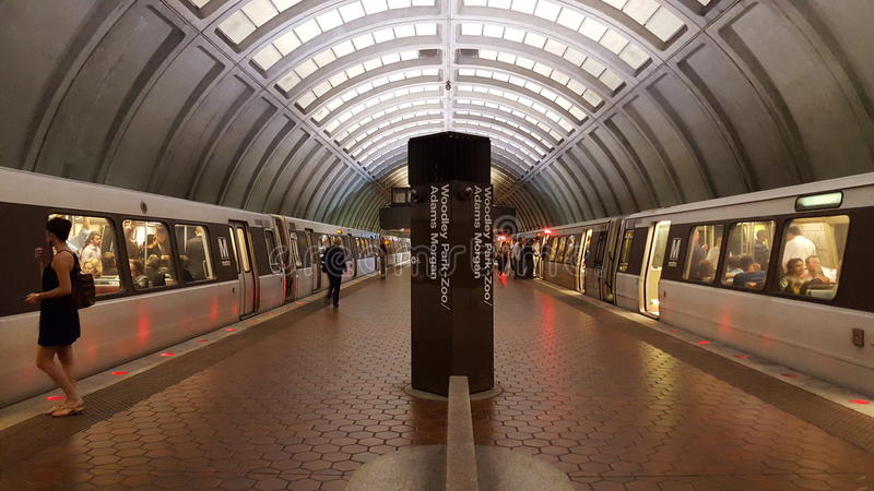 Interior of a WMATA subway station platform with passengers and two trains. Lower level interior view of the Woodley Park WMATA heavy commuter rail station royalty free stock photos