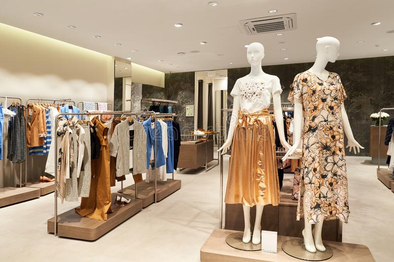Interior of women`s clothing store in the mall royalty free stock photography
