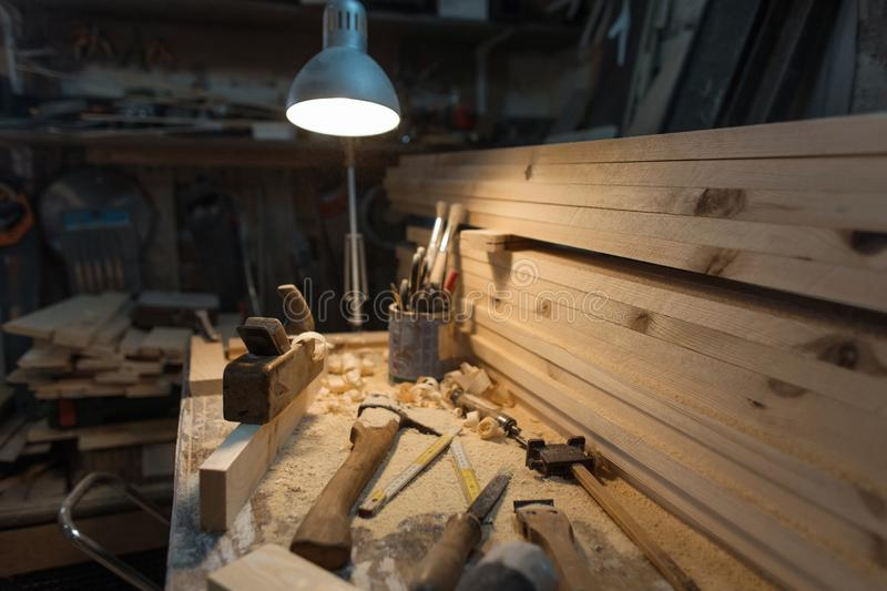 Interior of the wood workshop. Carpenter`s work table with tool.  stock photography