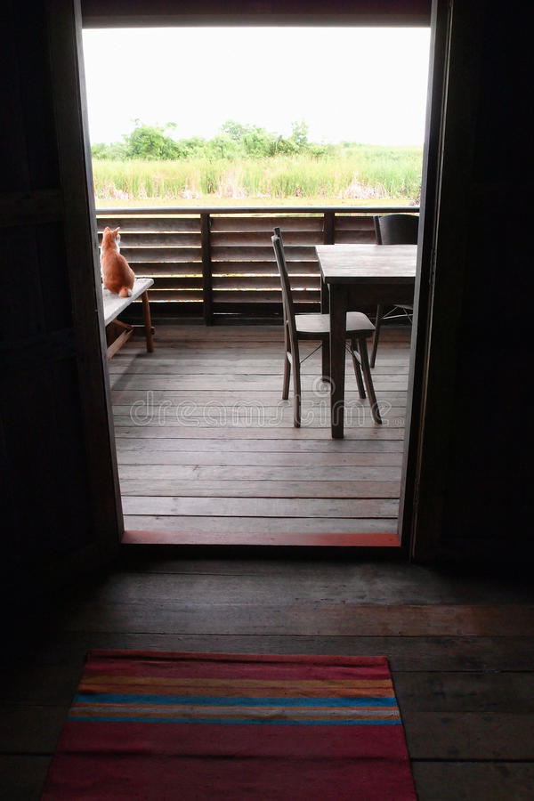 Interior, wooden asian house balcony view. A photograph showing an interior of an antique ethnic Malaysian village house in southeast asia. Taken through the royalty free stock photo