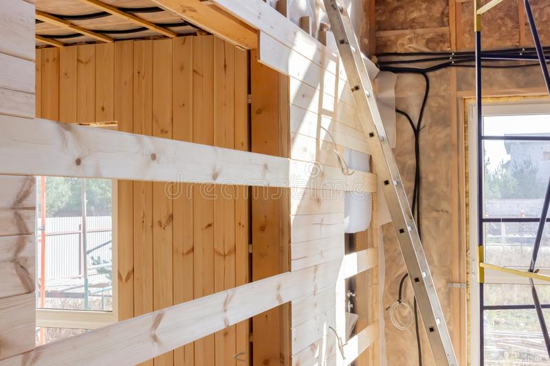 The interior of the wooden house. Construction of wooden houses. Home, room, architecture, design, floor, estate, real, window, empty, light, inside, wall royalty free stock images