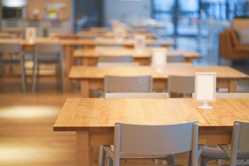 Interior of wooden table in food court shopping mall. Food center in department store. Interior of wooden table in food court shopping mall. Food center in stock images