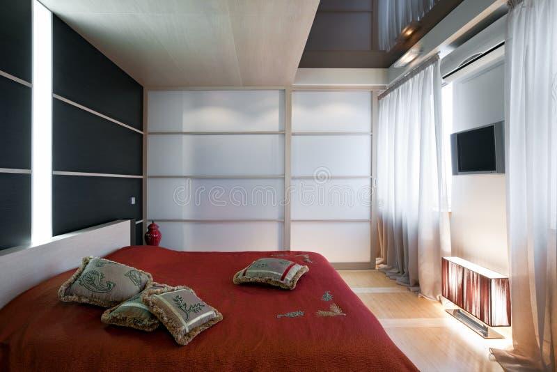 Interiore di lusso della camera da letto fotografia stock libera da diritti