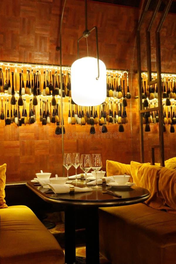 Interiores del restaurante de Mott 32, Hong-Kong fotografía de archivo