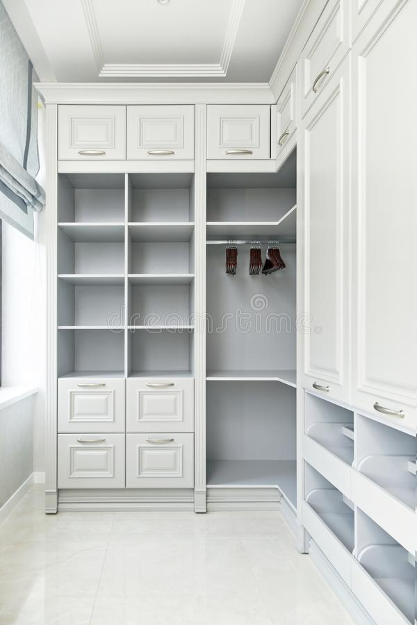 The interiors of the cottage: a large white wardrobe stock images