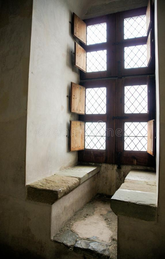 Benches near the window. Interiors of the halls and dungeons of the castle of Chillon stock images
