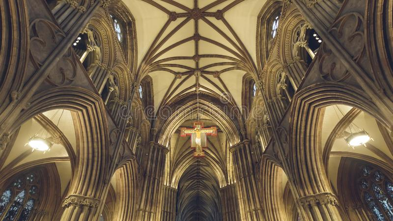 Interiors of Lichfield Cathedral - Icon - Hanging Cross and Ceiling in Nave. Lichfield, England - Oct 15, 2018: Interiors of Lichfield Cathedral - Icon - Hanging stock photography