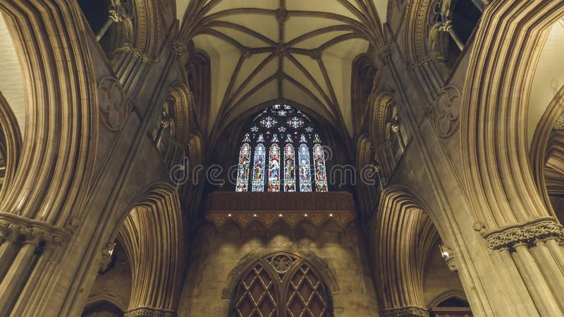 Interiors of Lichfield Cathedral - Stained Glass Window on West. Lichfield, England - Oct 15, 2018: Interiors of Lichfield Cathedral - Stained Glass Window on royalty free stock image