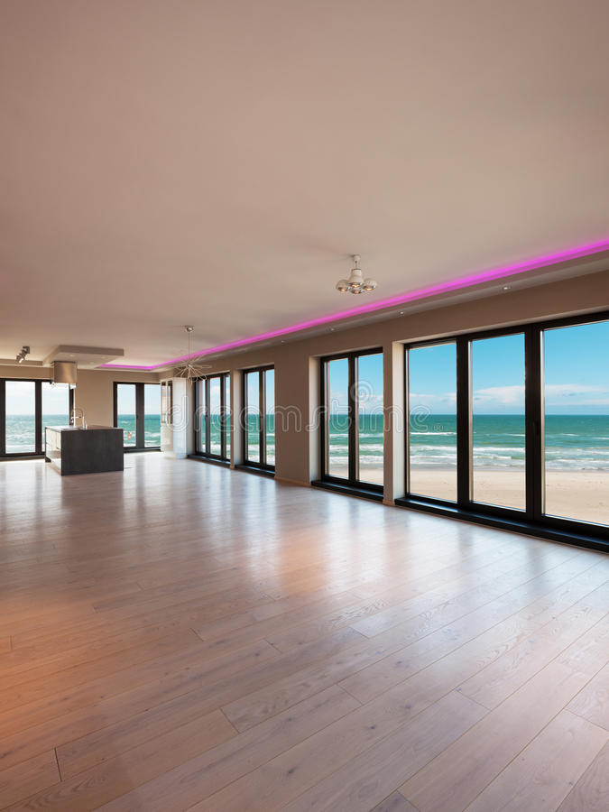 Interiors of a modern apartment, dining room with sea view royalty free stock images