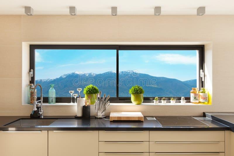 Interiors, modern kitchen. Architecture, modern house, beautiful interiors, detail kitchen royalty free stock photos