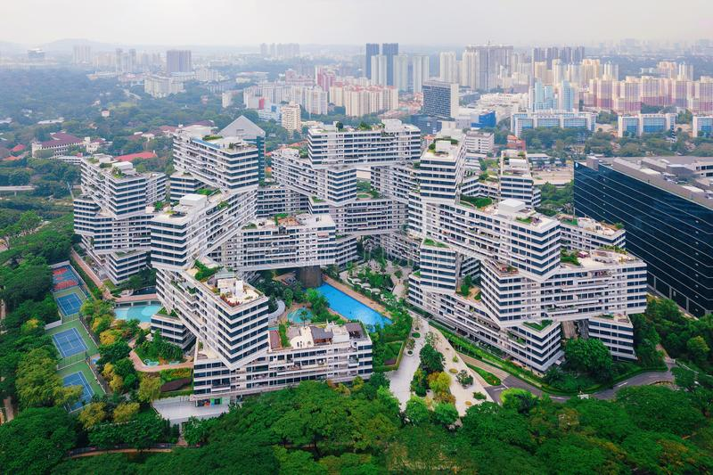 The Interlace apartments in Singapore city and skyscrapers stock photo