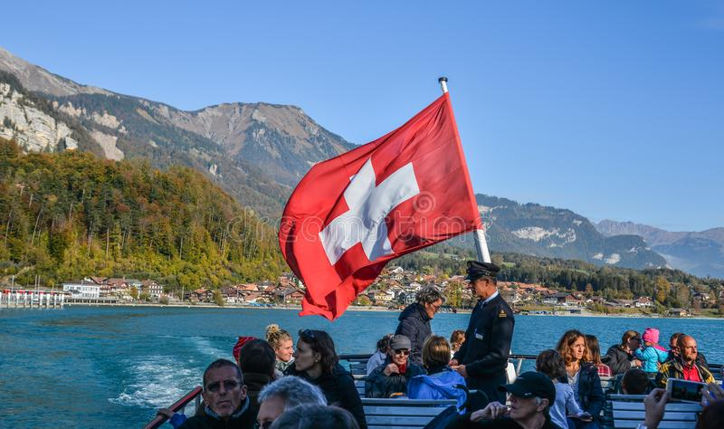 Swiss flag on tourist ferry royalty free stock photo