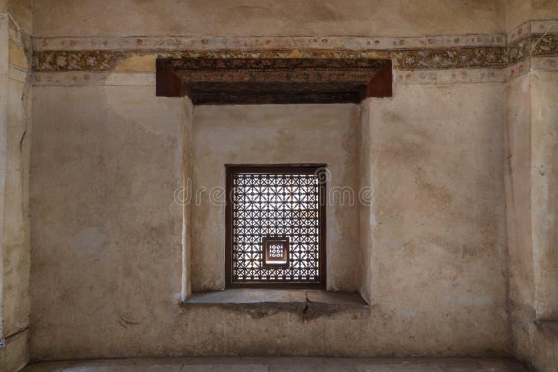 Interleaved grunge wooden window Mashrabiya, Medieval Cairo, Egypt. Interleaved grunge wooden window Mashrabiya at historic Beit El Set Waseela building Waseela royalty free stock photo