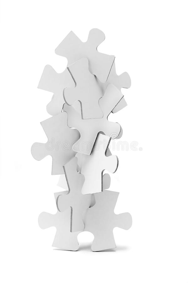 Interlocking pieces of jigsaw puzzles tower