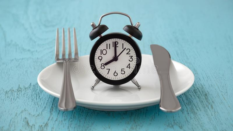 Intermittent fasting and meal planning concept. Clock on white plate with fork and knife, intermittent fasting, meal plan, weight loss concept on blue table royalty free stock photography