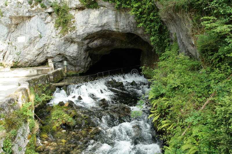 Intermittent fountain of Fontestorbes in Pyrenees. Ariege in south of France stock photos