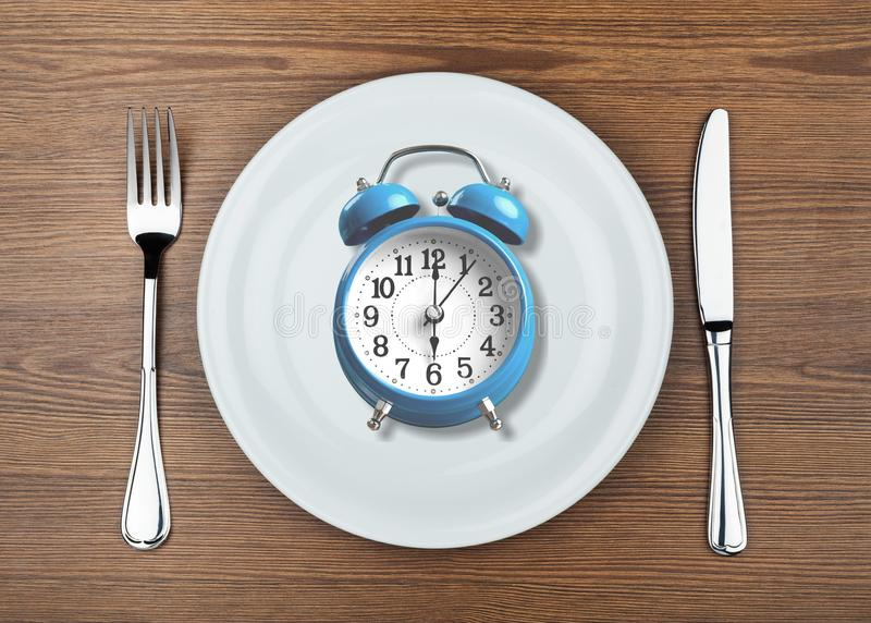 Intermittent. Fasting concept above breakfast clock delay stock images