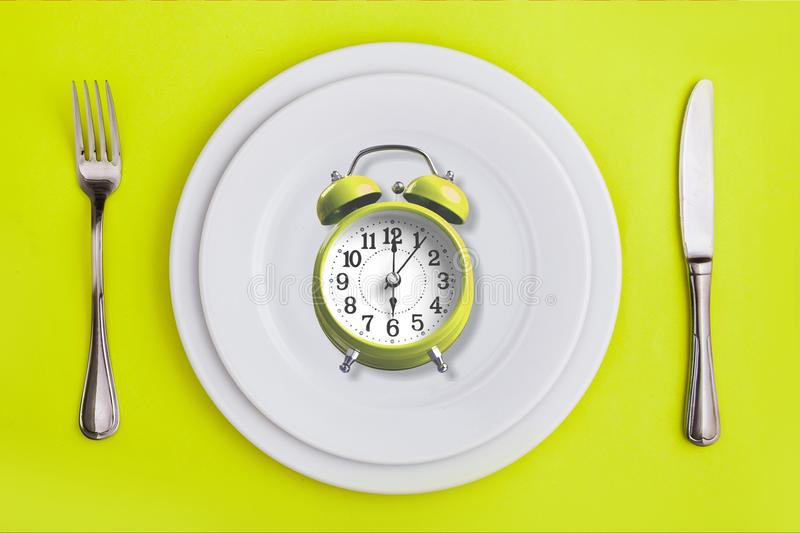 Intermittent. Fasting concept above breakfast clock delay stock image