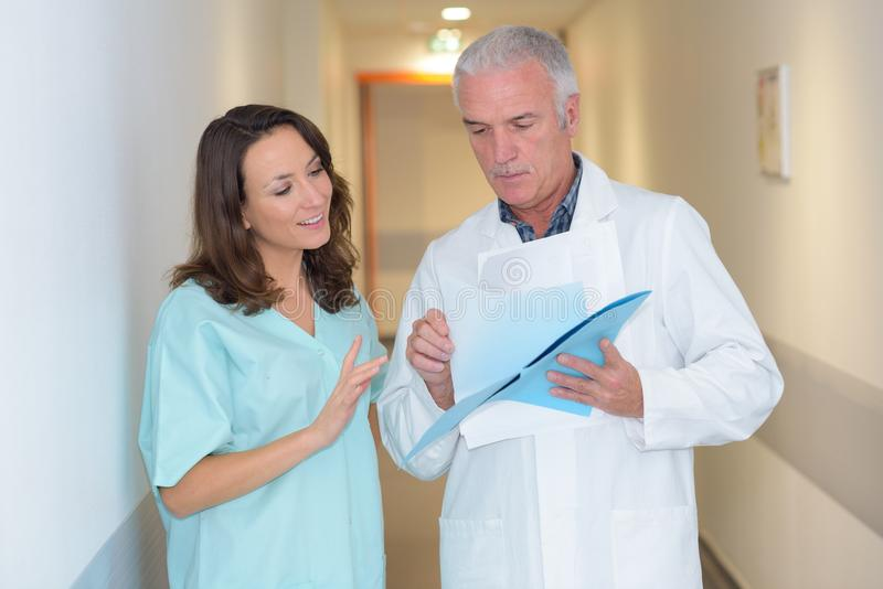 Intern and doctor on hallway. Intern and doctor on the hallway stock image