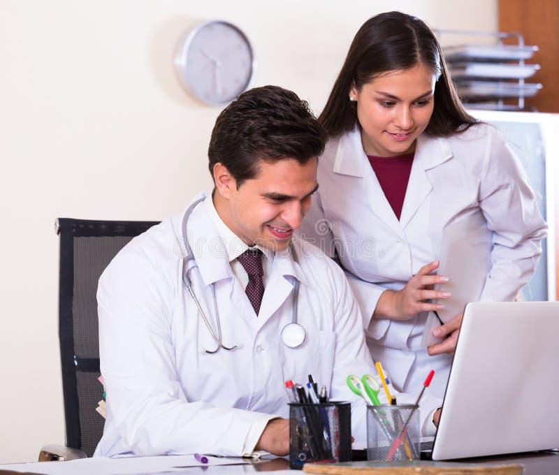Intern and medical tutor at clinic royalty free stock photos