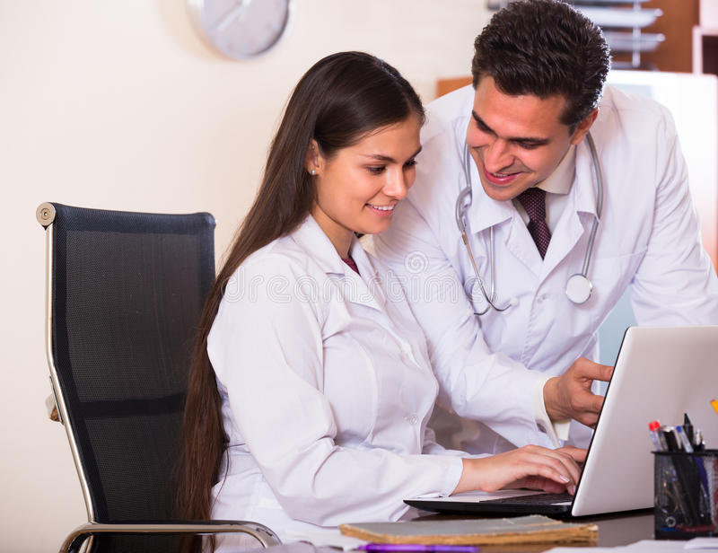 Intern and medical tutor at clinic royalty free stock images