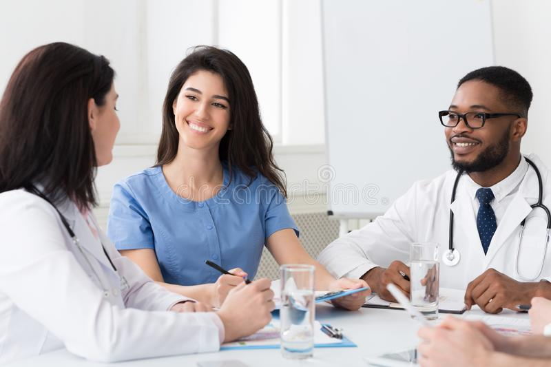 Intern with mentor talking and discussing questions stock images