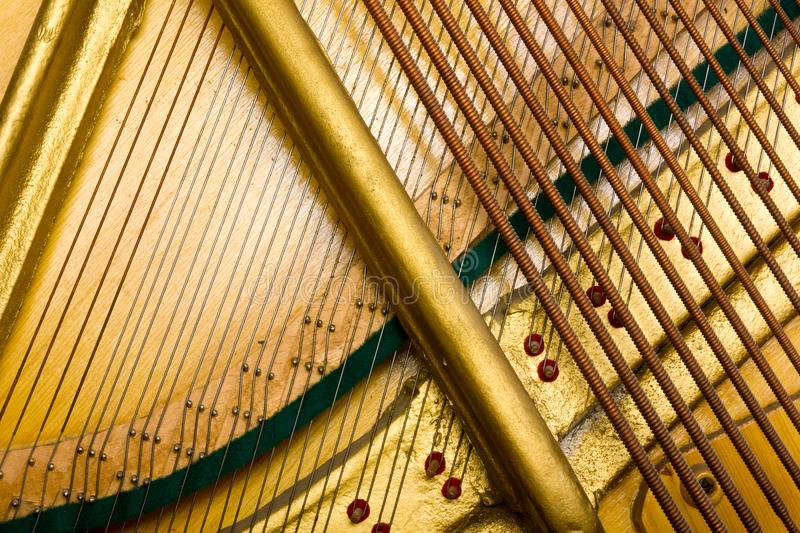 Internal arrangement of pianos, Theme of musical instruments. Background. royalty free stock image