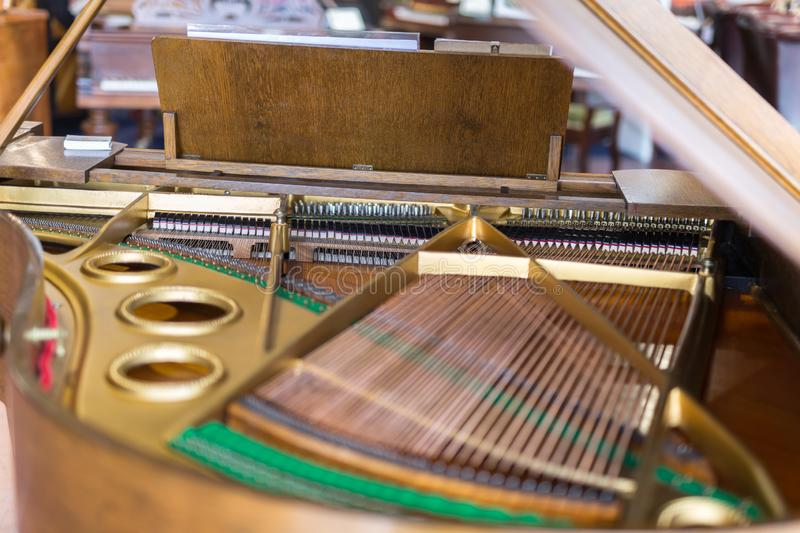 Internal Classic and Golden Piano Strings seen from above royalty free stock photo