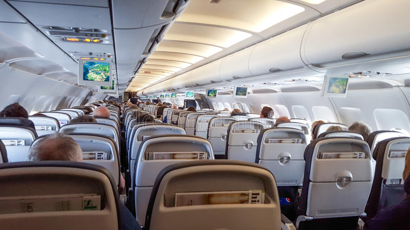 Internal view of an airplane in flight. Internal view of an airplane during a flight stock images