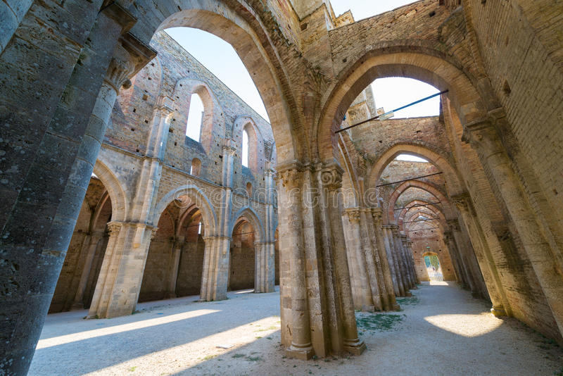 Internal view of the ruins of Medieval San Galgano Abbey near Si. Ena, Italy - example of romanesque architecture in Tuscany stock photo