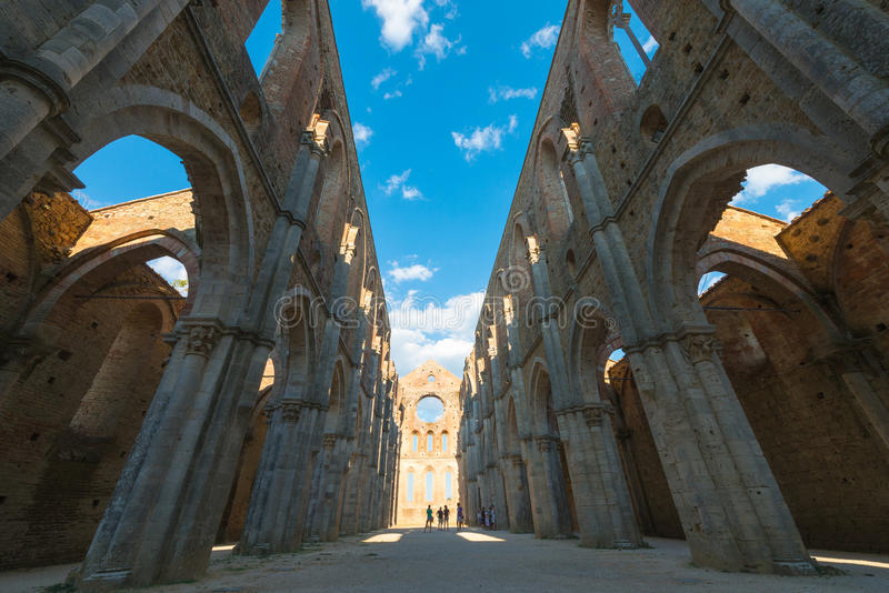 Internal view of the ruins of Medieval San Galgano Abbey near Si. Ena, Italy - example of romanesque architecture in Tuscany stock photos