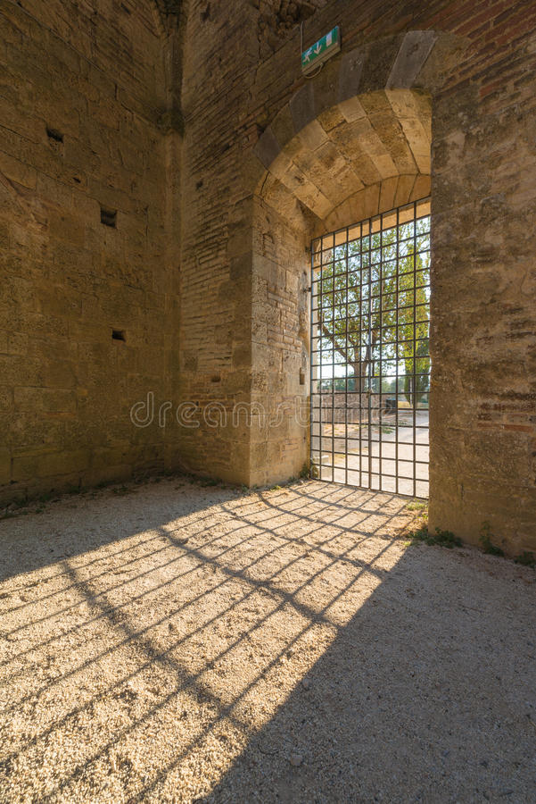 Internal view of the ruins of Medieval San Galgano Abbey near Si. Ena, Italy - example of romanesque architecture in Tuscany royalty free stock photography