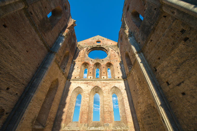 Internal view of the ruins of Medieval San Galgano Abbey near Si. Ena, Italy - example of romanesque architecture in Tuscany royalty free stock image