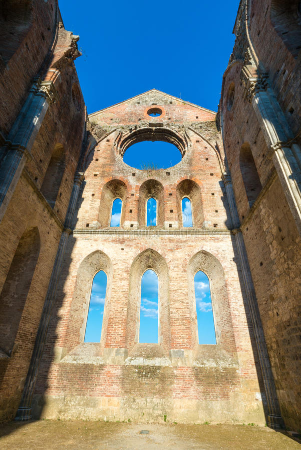 Internal view of the ruins of Medieval San Galgano Abbey near Si. Ena, Italy - example of romanesque architecture in Tuscany royalty free stock photos