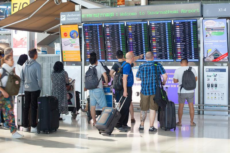 International Airport Suvarnabhumi people look at flight schedule screen, passengers near information display board royalty free stock images
