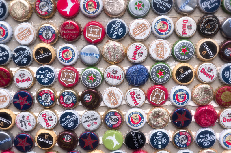 International Beer Caps. A variety of international beer bottle tops on a wall in Tianzifang Shanghai China stock images
