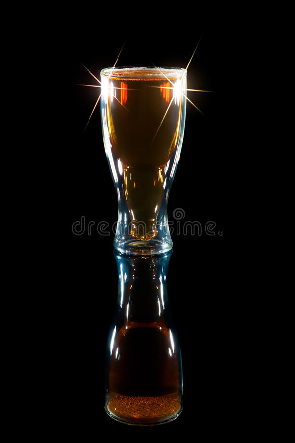 International Beer Day. Soft image of a pint of lager in a bottle shaped glass. Award winning beer. royalty free stock photography