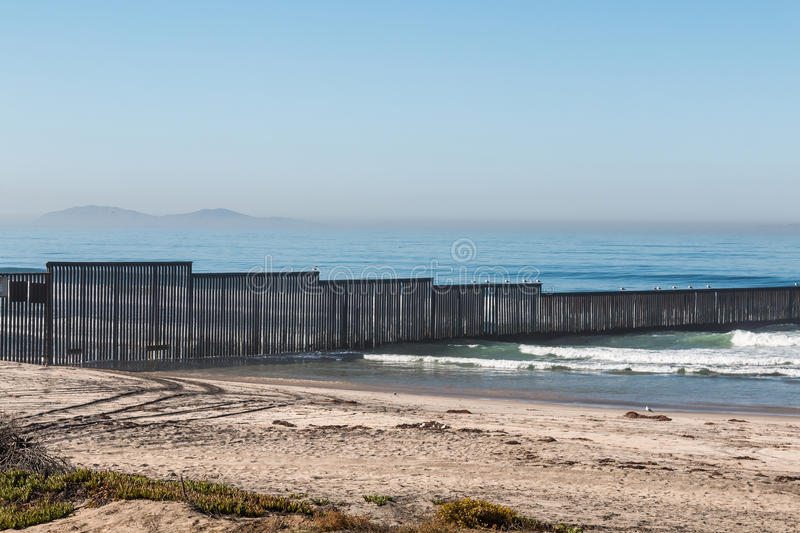 International Border Wall in San Diego with Los Coronados Islands royalty free stock photography