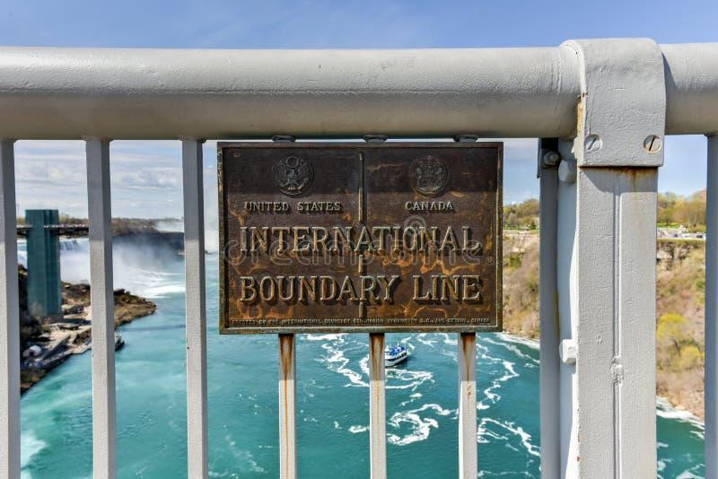 International Boundary Line - USA and Canada. International Boundary Line between the United States and Canada on the Rainbow Bridge at Niagara Falls royalty free stock photography