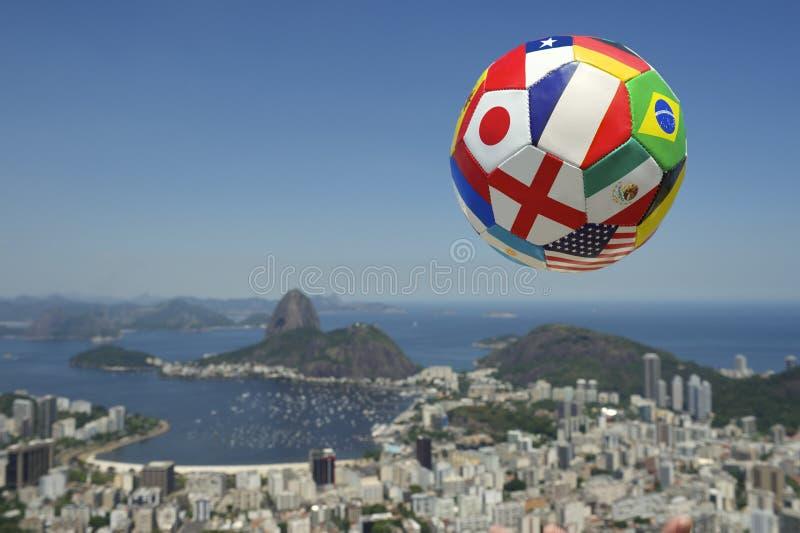 International Brazil Football Soccer Ball Above Rio de Janeiro. International football soccer ball above Rio de Janeiro skyline with Sugarloaf Pao de Acucar royalty free stock images